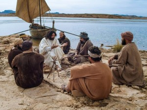 Photo of Jesus and disciples sitting by a boat.